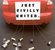 Just Civilly United Board Tied with Tin Cans Behind Red Car